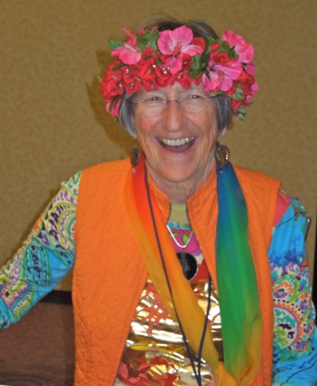 Lydia Rule filled the conference space with the vibrant force of her colorful spirit in her person and her world goddess banners.